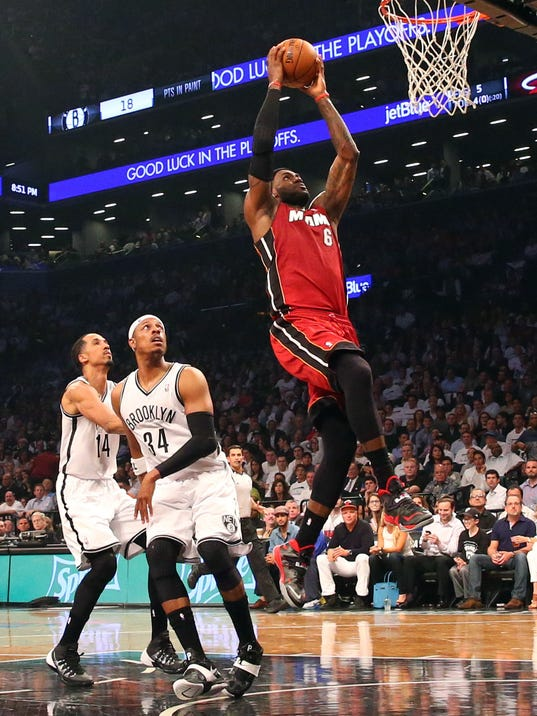 LeBron James ties playoff career high as Heat beat Nets in ...