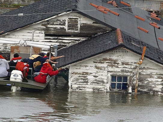 Ronald Wood is rescued from his home in New Orleans