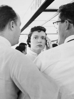 A woman pauses with a look of stunned horror in St. Louis, July 1, 1956 after receiving word that a TWA airliner on which her half sister was traveling for a visit. The plane's wreckage was found later in the Grand Canyon.