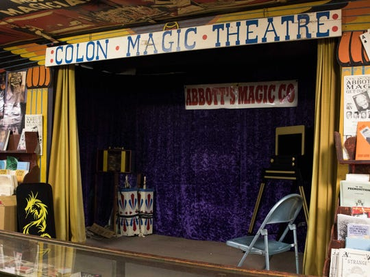 A small stage set up in the back of Abbott's Magic Co. is ready for performances.