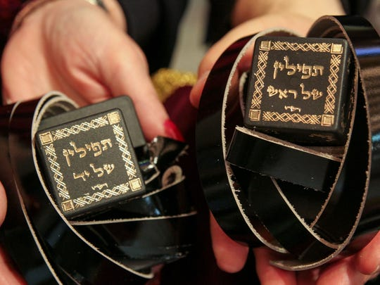 Wall, NJ Rabbi Robert Pilavin of the Congregation Sons of Israel in Manalapan and Susan Feinstein hold a special pair of tefillin that will be dedicated in honor of late congregant Howard Feinstein, Susan's late husband. 01022015 Tom Spader/Staff Photographer