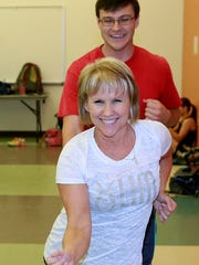 Sheila Mobley, front, rehearses a salsa dance with Utah Ballroom Dance Company instructor Chris Rogowski on Thursday at the Sycamore Park Community Center.