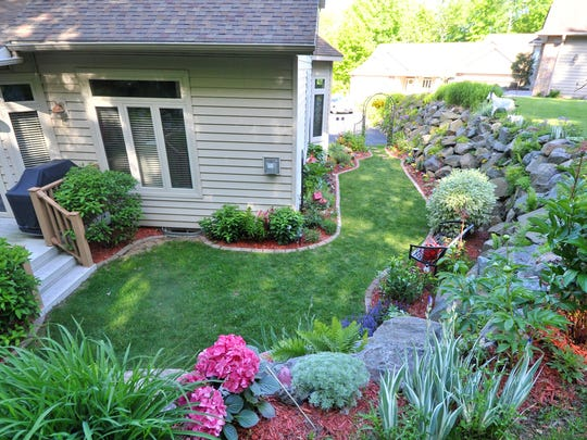 Lynn Reichelt's garden in Rib Mountain has been chosen as the YWCA Garden of the Month for June.