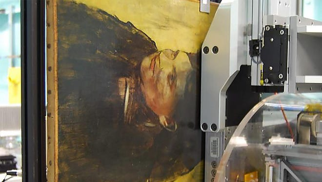 "This undated handout picture released on August 4, 2016 by the Nature publishing Group shows an Edgar Degas painting ""Portrait of a Woman"" as it appears during the imaging scan. The MAIA Detector is carefully positioned less than 2 mm from the paintings surface in order to achieve the highest quality data. The detector collects data simultaneously over 384 channels, which means that much higher resolutions are achieved in much shorter time spans when compared to single point detectors. An experiment that would take weeks of beam time by conventional methods is reduced to only 20 to 30 hours."