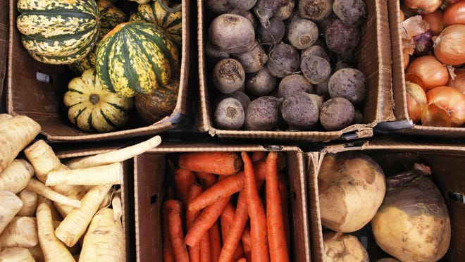 Root vegetables from Newgate Farms in Connecticut are for sale at the indoor famers market in Pleasantville Middle School.