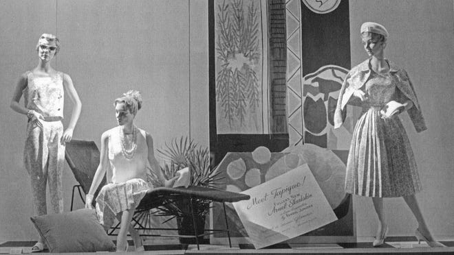 A winter 1959 Ayres window display shows signs of spring fashions.