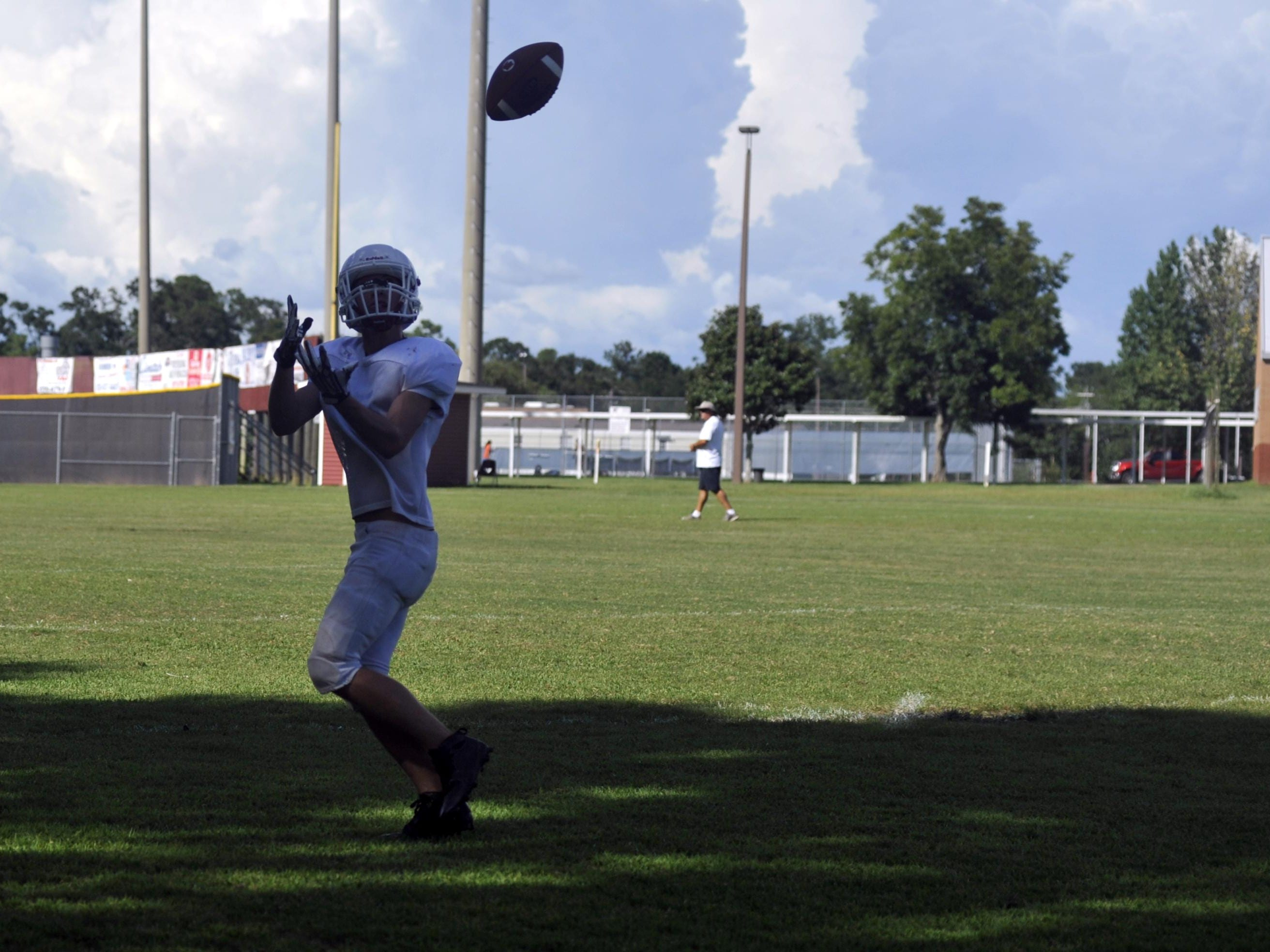 A Tate wide receiver catches a pass during practice on Aug. 16, 2016.