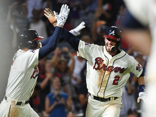 Atlanta's Dansby Swanson (2) scores the game-winning run during the 10th  inning against the New York Mets on Sept. 10, 2016.