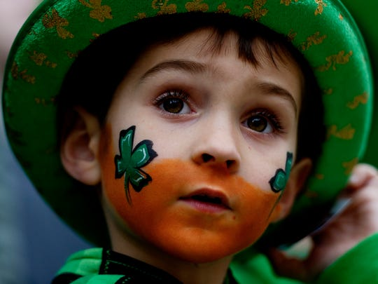 Trevor Ray, 5, of Knoxville, adjusts his hat during the Knoxville St. Patrick's Day Parade in downtown Knoxville, Tennessee on Friday, March 17, 2017. After an almost 30-year absence, the Knoxville St. Patrick's Day parade returned this year.