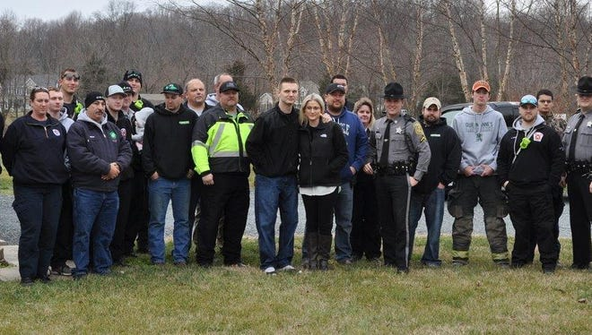 Deputy Scott Hogan (center, with a black jacket and blue jeans) returned home on Monday after being shot on Dec. 29.