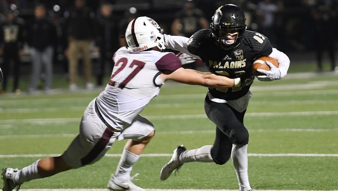 Paramus Catholic's Matthew Zelaya fights off a tackle in the second quarter.