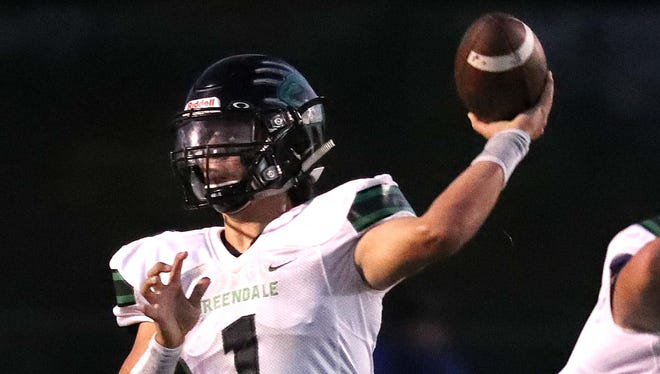 Greendale quarterback Mitchell Gnadt looks for an open receiver.