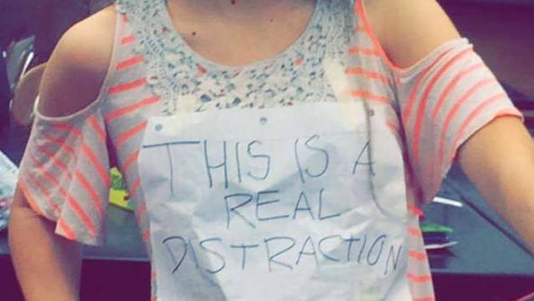 Some students wore shirts and banners to protest the