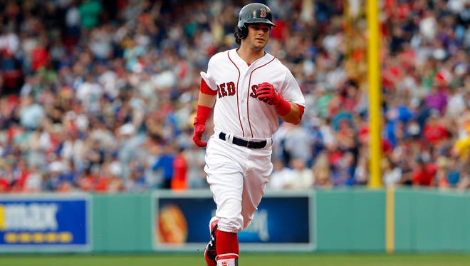 Boston Red Sox left fielder Andrew Benintendi (16) rounds the bases after hitting a home run against the Chicago Cubs during the fifth inning at Fenway Park on April 29.