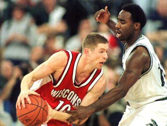 Jon Bryant #10 of Wisconsin tries to dribble around