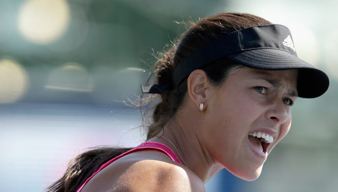 Ana Ivanovic of Serbia reacts after winning a point during her match against Sabine Lisicki of Germany during Day 2 of the Bank of the West Classic at the Taube Family Tennis Stadium.