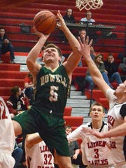 Howell's Logan Ward goes to the basket in a 74-68 overtime victory at Linden.