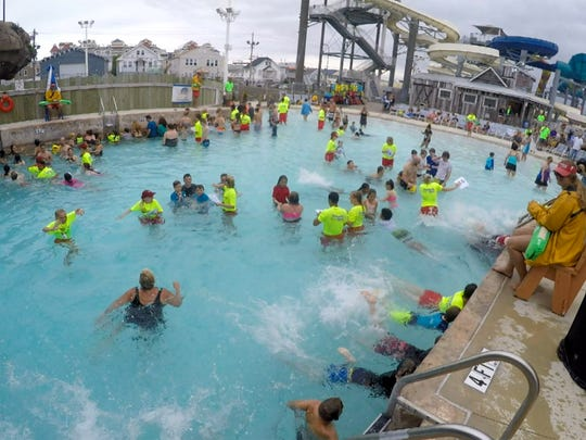 People take part in the World's Largest Swimming Lesson at the Breakwater Beach water park in Seaside Heights Thursday, June 21, 2018.  This event is intended to show people how important it is for children to learn how to swim.