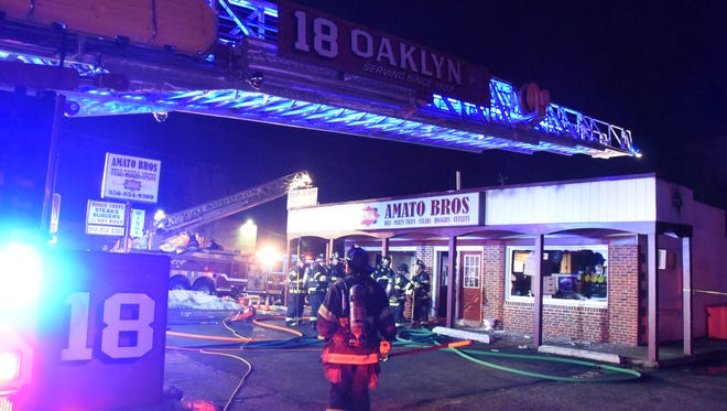 Fire heavily damaged Amato Bros. Deli on the White Horse Pike in Oaklyn Sunday night.    Firefighters from several towns were on the scene,  and it took just about 30 minutes to declare the fire under control. There were no injuries to firefighters The store had closed for the night a few hours earlier. The fire is under investigation by local and county fire marshals and the Camden County Prosecutor's fire investigators.  Photo:   Curt Hudson/Oaklyn FD