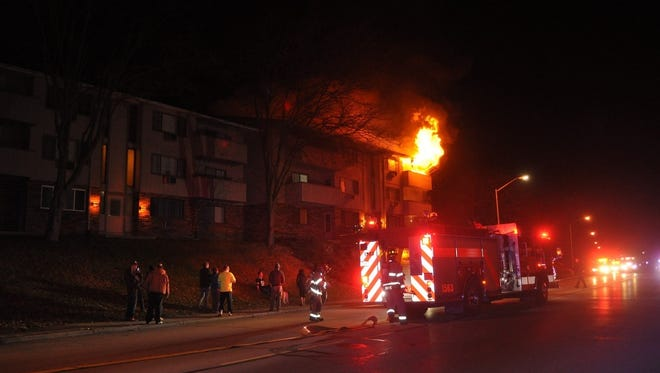 A third floor balcony of an apartment building is on fire, likely through careless use of smoking materials, according to the Waukesha Fire Departrment.