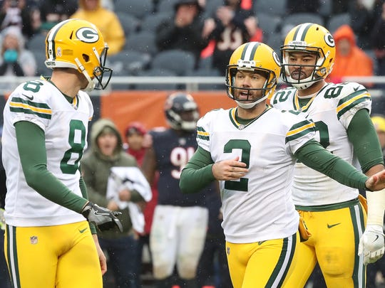 Green Bay Packers kicker Mason Crosby (2) talks with