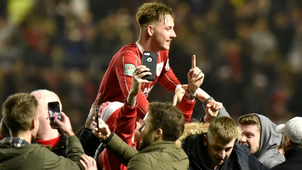 Bristol's Josh Brownhill is hoisted on fans shoulders