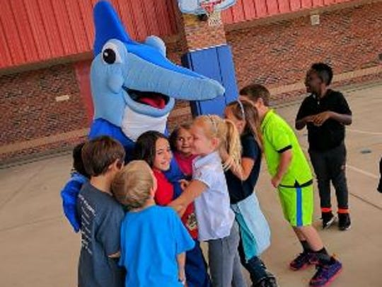 Sailfish Splash mascot Splash B. Sailfish visits Sea Wind Elementary in Hobe Sound to announce the students had won the naming competition for the Waterpark's newest attraction.