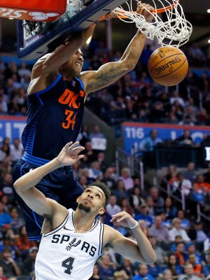 Josh Huestis, then of Oklahoma City, dunks on San Antonio's Derrick White last season. Huestis recently signed a contract with the Spurs.