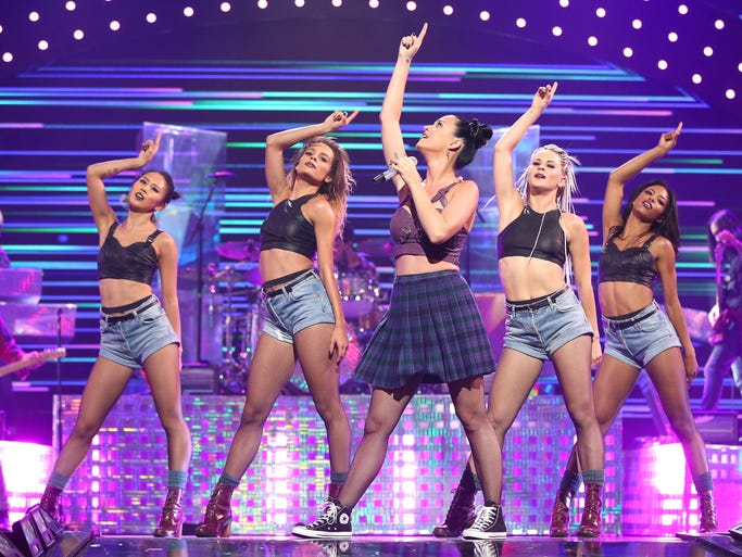 Katy Perry performs onstage with her dancers during the iHeartRadio Music Festival at the MGM Grand Garden Arena on Sept. 20, 2013, in Las Vegas.
