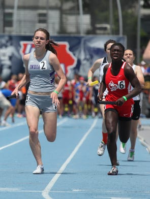 Indianola's Kate Bishop and Iowa City High's Fanta Traore come to the finish in a preliminary heat of the 4x400 relay Friday at the Class 4-A co-ed state track meet at Drake Stadium in Des Moines.