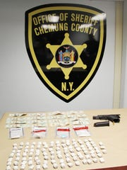 The Chemung County Sheriff's Office seized guns, cash and $17,500 worth of heroin from a Columbia Street residence Friday.