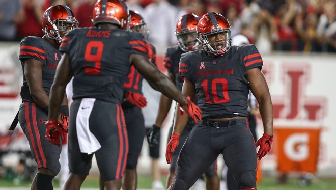 Houston defensive tackle Ed Oliver celebrates after a play during the third quarter of Houston's win over Louisville.