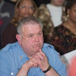 Camden Fire Chief, Joseph Marini listens to comments made during the Cramer Hill City Council caucus meeting in Camden, N.J.