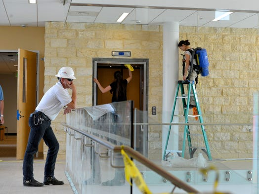 A man looks out over the central atrium of Mary Baldwin College's Murphy Deming College of Health Sciences in Fishersville.