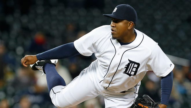 Detroit Tigers pitcher Angel Nesbitt throws against the Minnesota Twins in the tenth inning of a baseball game in Detroit Tuesday, May 12, 2015.