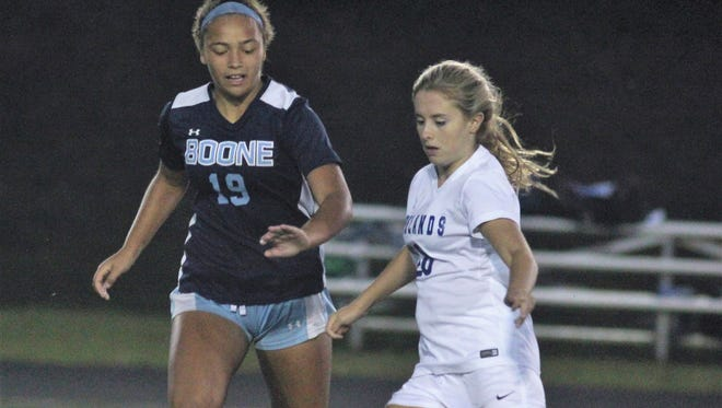 Boone County junior Rielyn Hamilton, left, and Highlands sophomore Abby Stein contest the ball during Highlands 3-0 win over Boone County in girls soccer Sept. 28, 2017 at Tower Park in Fort Thomas. Maria Broering scored two goals and Lindsey Meyer one as Highlands improved to 13-4-1.