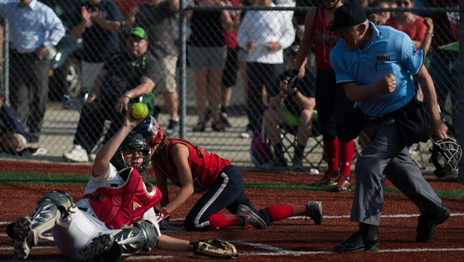 Eastern's Rae D'Onofrio, left, tags out Washington Township's Kasie McNichol to win the game 2-1 in the South Jersey Group 4 quarterfinal Wednesday, May 25 in Voorhees.