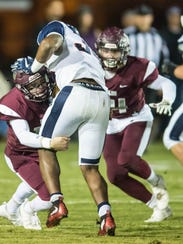 Vermilion Catholic defenders try to stop Lafayette Christian Academy's run game Friday in the LHSAA Division IV semifinals.