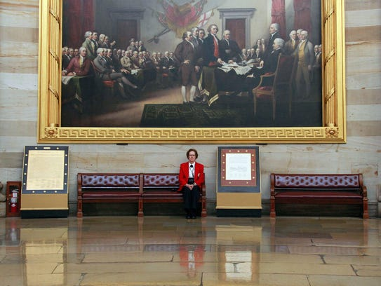 """John Trumbull's """"Declaration of Independence"""" is a"""