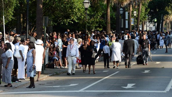 Mourners gather in Charleston.