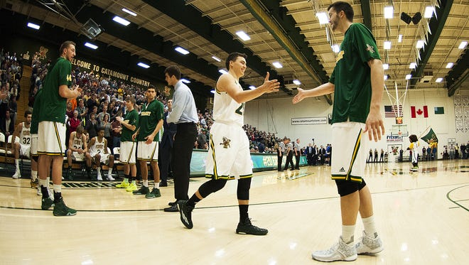 Catamounts guard Ernie Duncan (20) takes the court for player introductions during the men's basketball game between the UC Santa Barbara Gauchos and the Vermont Catamounts at Patrick Gym on Wednesday night.
