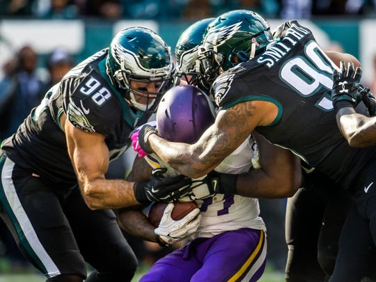 A trio of Philadelphia Eagles defenders swarm of Minnesota Vikings running back Jerick McKinnon in the third quarter of the Eagles 21-10 win over the Vikings at Lincoln Financial Field in Philadelphia on Sunday afternoon.