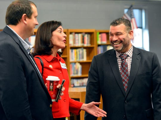 Rep. Seth Grove, 196th District, left, and Rep. Kristin Phillips-Hill, 93rd District, share a laugh with Pennsylvania Secretary of Education Pedro Rivera during a visit to Dover Area High School, Thursday, Dec. 8, 2016. John A. Pavoncello photo