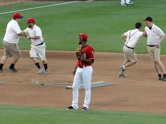 El Paso Chihuahuas infielder Jose Rondon watches as the grounds crew drop what they were doing to dance to a song Sunday at Southwest University Park.