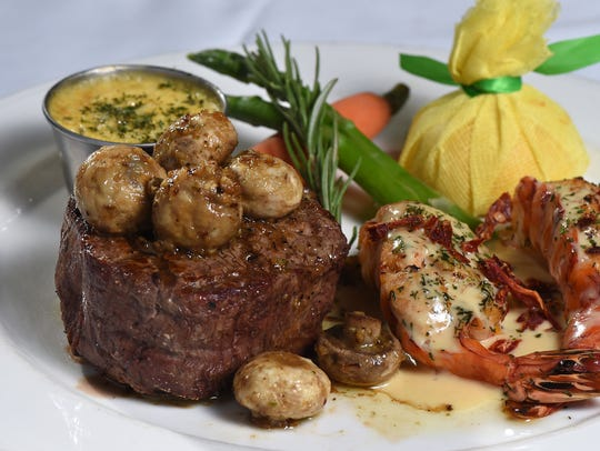 Steak and lobster with lemon fondue butter ranks among