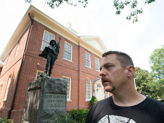 Michael Engels of Easton in front of the Talbot County Courthouse in Easton, where the Talbot Boys monument is located.