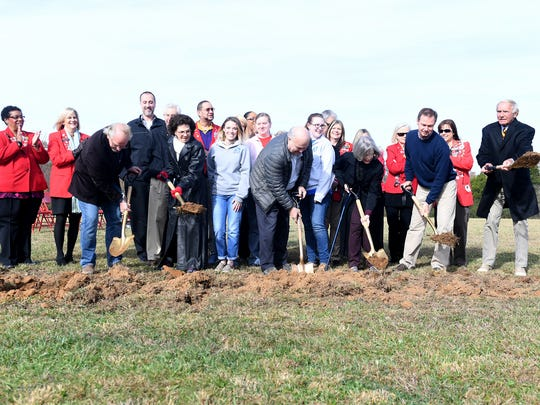 Hal Crocker (left), Vicki Lake (2nd to the left), Harry Henry (center), Kathleen Huneycutt (3rd to the right), Frank McMeen (2nd to the right), and Mayor Jerry Gist (right) shovel dirt into the ground in where the new Jackson Animal Care Center was supposed to be located.