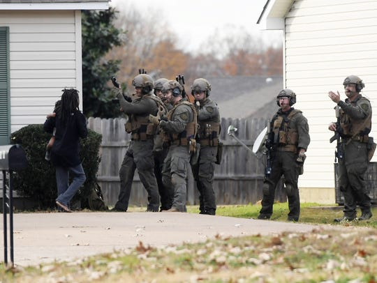 A woman walks toward members of the Jackson Police