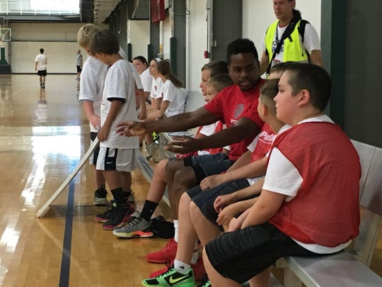 Former IU star Yogi Ferrell instructs youths at his two-day ProCamp summer basketball camp.