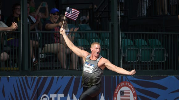 Jul 4, 2016; Eugene, OR, USA; Cyrus Hostetler takes a victory lap after winning the javelin at 273-1 (83.24m) during the 2016 U.S. Olympic Team Trials at Hayward Field. Mandatory Credit: Kirby Lee-USA TODAY Sports